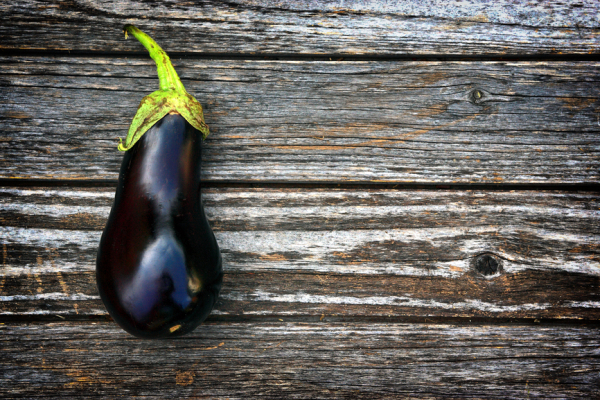 Aubergine on woob background