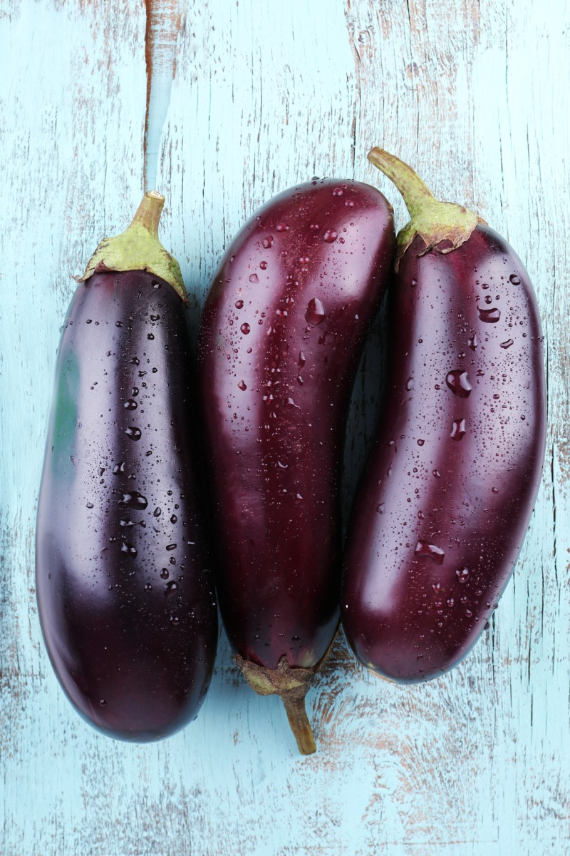 Aubergines on wooden background