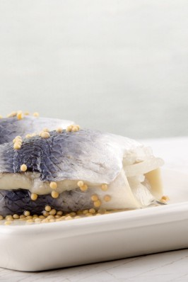 rollmops with mustard seed on a plate